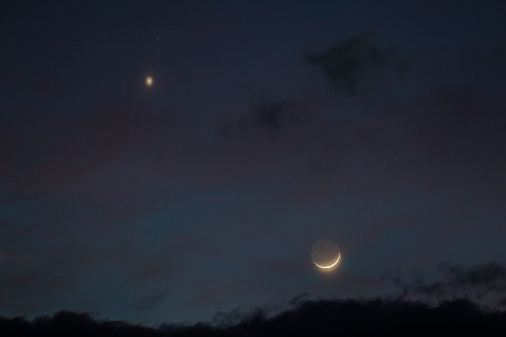 Venus in the night sky with the crescent moon